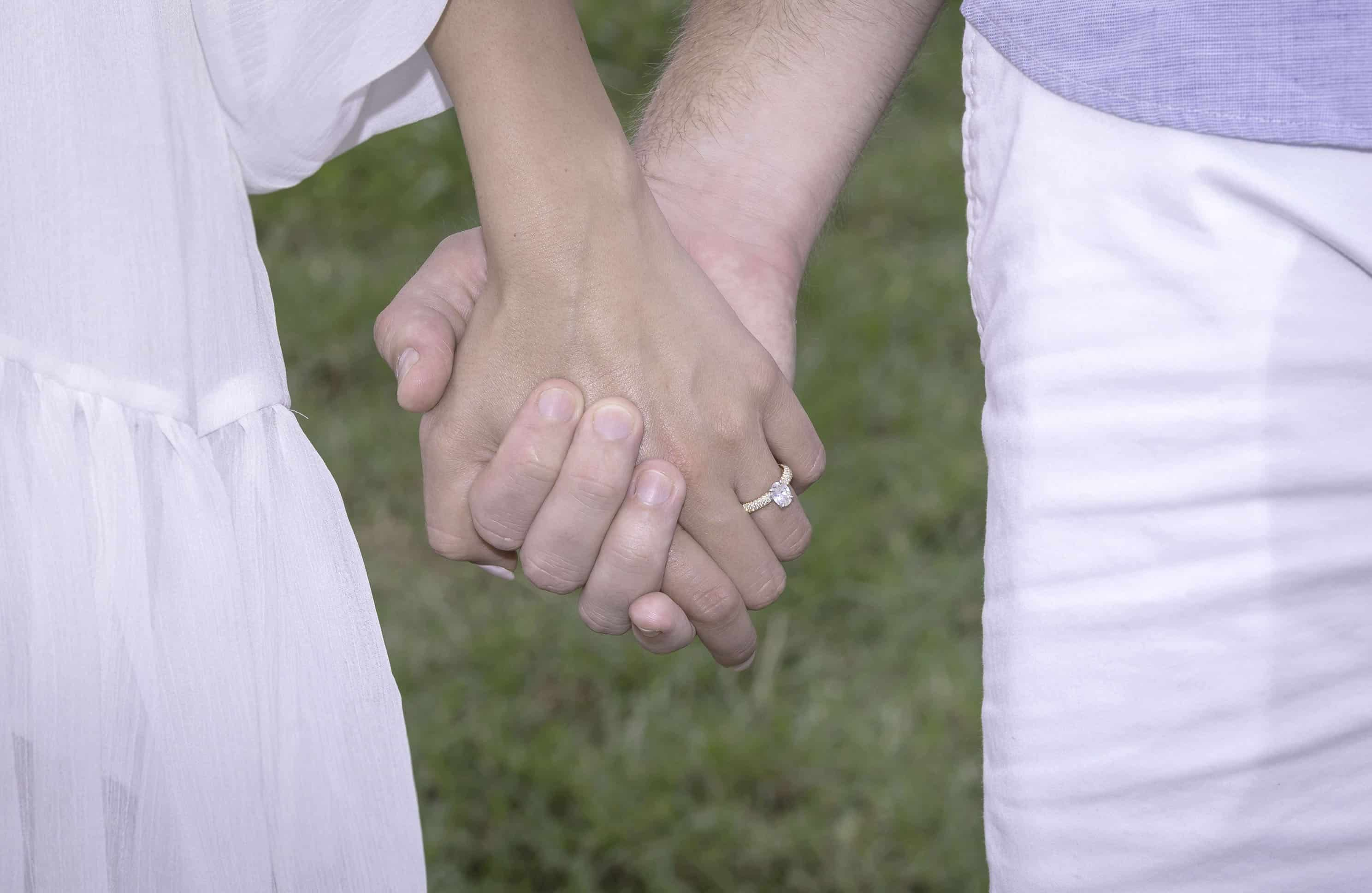 A couple showing off their wedding Rings